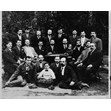 Chevre Gemilas Chasodim Anshei England, Toronto, [1910 or 1911]. Ontario Jewish Archives, Blankenstein Family Heritage Centre, item 1902.|Photograph of Chevre Gemilas Chasodim Anshei England, Toronto, taken in back yard of Hebrew Men of England Synagogue, Toronto (Simcoe Street). Back row, 2nd left - Fine; 2nd right - Greenberg; 1st right - Taub. Second row, 5th right - Solomon Blumstein, 1870-1931, with son Charles, age 5; 3rd right - Rabbi. First row - 2nd left - Yanikoff; Child in front - Yarmolinsky.