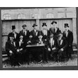 Group at opening of Hebrew Men of England Synagogue, Spadina Ave., Toronto, 1921. Ontario Jewish Archives, Blankenstein Family Heritage Centre, item 1903.|This item is a group photograph taken at the opening of the Hebrew Men of England Synagogue on Spadina Avenue. It features members of the synagogue seated in the backyard wearing top hats and tails. Rabbi Jacob Gordon is pictured in the first row, third from the left.
