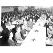 Jewish National Fund dinner at the Zionist Institute, [ca. 1936]. Ontario Jewish Archives, Blankenstein Family Heritage Centre, fonds 33, series 4, item 8.|This item is an orignal photograph, copy photograph and negative of a Jewish National Fund dinner held at the Zionist Institute in Toronto, located at Beverley and Cecil Streets. The guests are seated at several banquet tables and are posing for the photograph. Bill Stern's parents, Moishe and Fanny Stern, and Meyer Shaprio, editor of the Yiddisher Zhurnal, are pictured in the photograph.