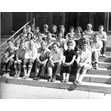 Counselors and staff seated on the front steps of a building, 1957. Ontario Jewish Archives, Blankenstein Family Heritage Centre, fonds 33, series 5, file 7.|