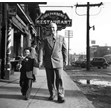 Looking south on east side of Spadina Ave. north of Dundas St., Toronto, [1947 or 1948]. Ontario Jewish Archives, item 4033.|Joseph Barsh's father was Benjamin Barsh, the owner of the Standard Barber Shop. This photographs was taken in front of the shop. Joseph appears with his son Preston Barsh.