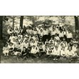 Etta Taube on a class outing, [192-]. Ontario Jewish Archives, Blankenstein Family Heritage Centre, item 4531.|This item is a photograph of a Lansdowne School class outing in Toronto. The photograph features a large group of kids assembled in a park. Etta Taube (m. Mrs. John Sherman) is pictured seated in the front row, second from the left.