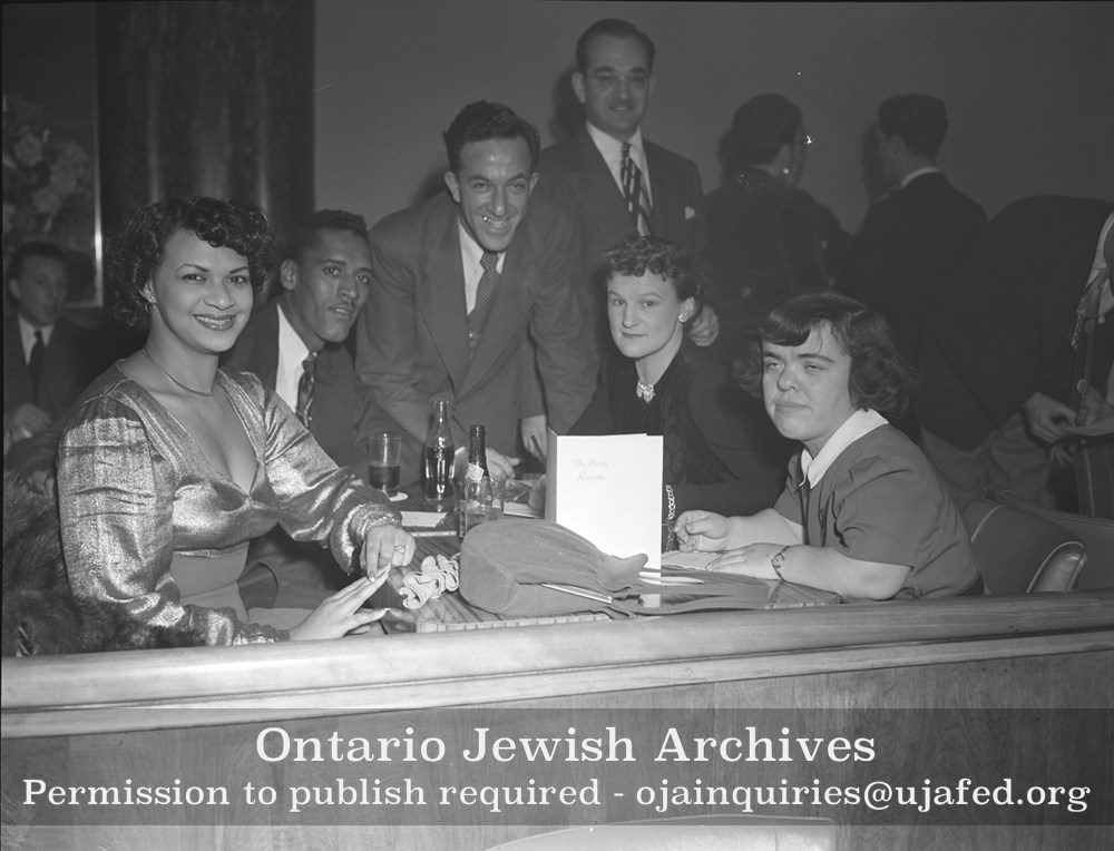 Phyllis Marshall, Sylvia Schwartz and some unidentified persons at a